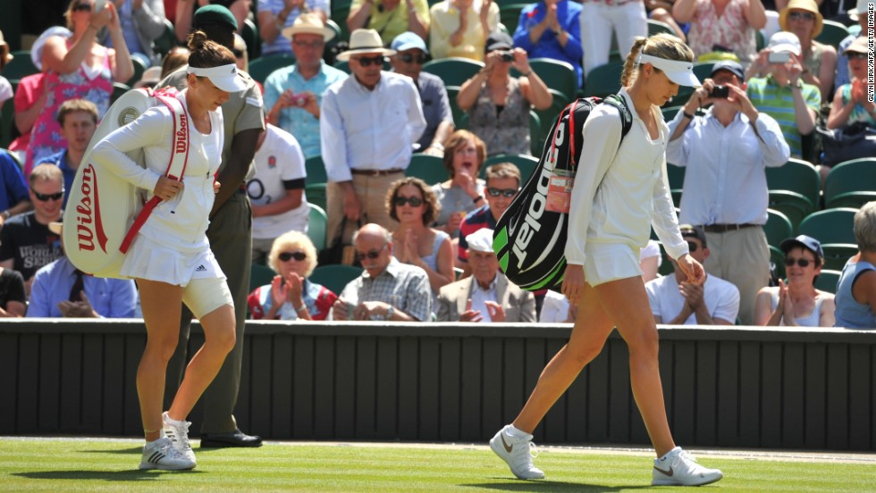 Bouchard and Halep arrive on Centre Court ahead of their match to the applause of the crowd.