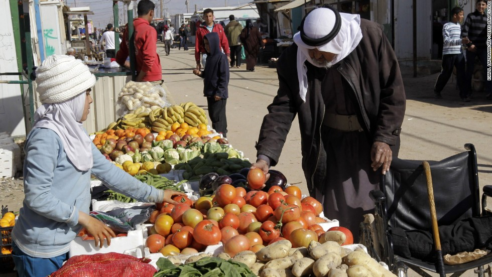 Tribal leaders, meanwhile, say that the influx of Syrian refugees into Jordan has created tension with the local population and driven down wages. Here, a vendor sells fruit and vegetables at the Zaatari refugee camp near Mafraq.
