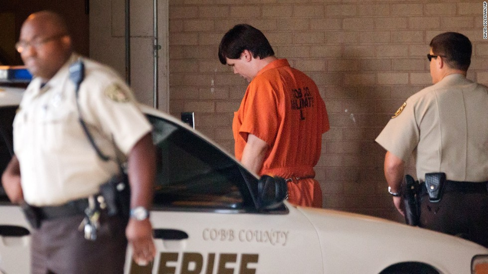 """Justin Ross Harris, center, arrives for a probable cause hearing Thursday, July 3, in Marietta, Georgia. A Cobb County judge ruled that Harris <a href=""""http://www.cnn.com/2014/07/03/justice/georgia-hot-car-toddler-death/index.html"""">will face murder and child cruelty charges</a> for the death of his 22-month-old son, Cooper. Police say Harris left Cooper in a hot car for seven hours while he went to work on June 18. Harris has pleaded not guilty."""