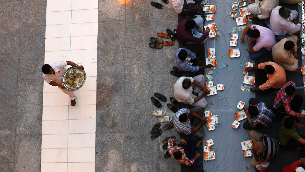 "Muslims at a mosque in Riyadh, Saudi Arabia, wait to eat a meal on Sunday, June 29, the first day of <a href=""http://religion.blogs.cnn.com/2014/06/28/the-belief-blog-guide-to-ramadan/"">the holy month of Ramadan</a>. During Ramadan, Muslims across the globe will be fasting, praying and abstaining from sex and smoking during daylight hours. Many call it a time of spiritual purity and rededication to God."