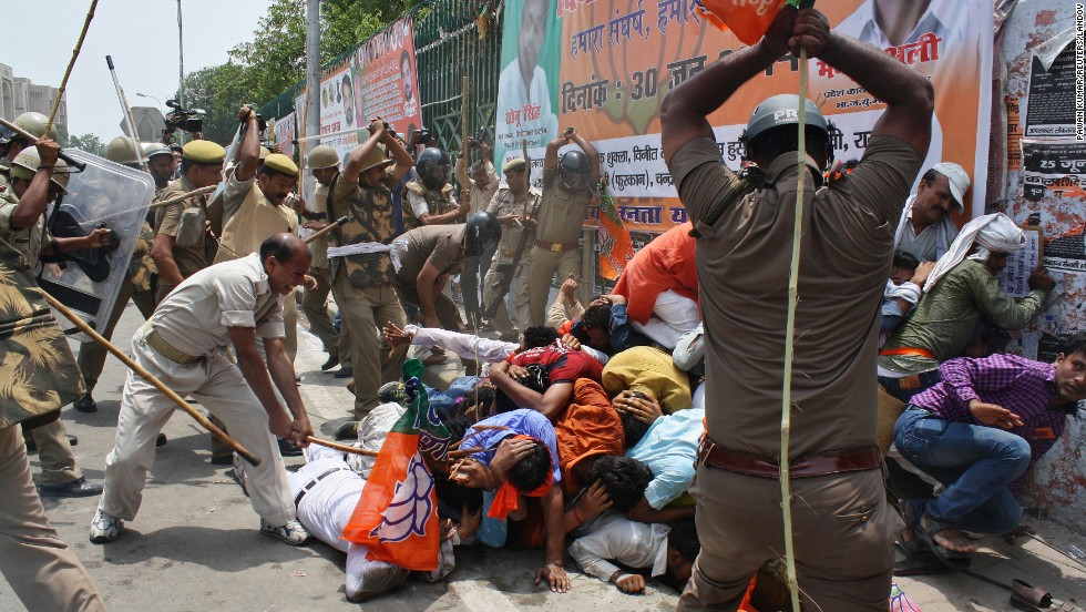 Policemen use batons to disperse youth wing workers of India's ruling Bharatiya Janata Party during a protest Monday, June 30, outside the state assembly in Lucknow, India. Hundreds of workers protested what they say is a deteriorating law-and-order situation in the Uttar Pradesh state, local media reported.