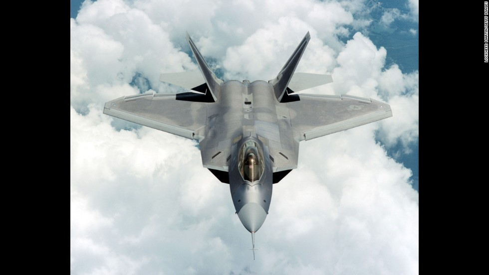 A F-22 Raptor flies over Marietta, Georgia, home of the Lockheed Martin plant where it was built. The F-22 is the only fighter capable of simultaneously conducting air-to-air and air-to-ground combat missions.