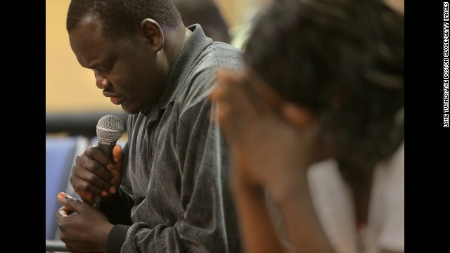 MANCHESTER, NH - MAY 25: Pastor Monyroor Teng leads a prayer at the Sudanese Evangelical Covenant Church. (Photo by Lane Turner/The Boston Globe/Getty Images)