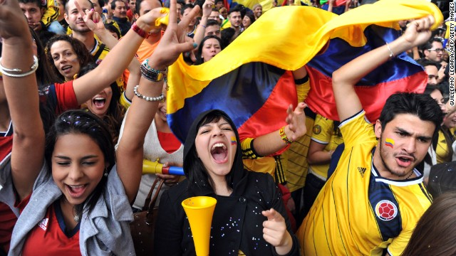 Caption:Colombian fans celebrate during the fan fest in Bogota, on June 28, 2014 as they watch the FIFA World Cup Brazil 2014 second round match between Colombia and Uruguay in a big screen. Colombia won 2-0 and reached the quarter-finals. AFP PHOTO/Guillermo LEGARIA (Photo credit should read GUILLERMO LEGARIA/AFP/Getty Images)