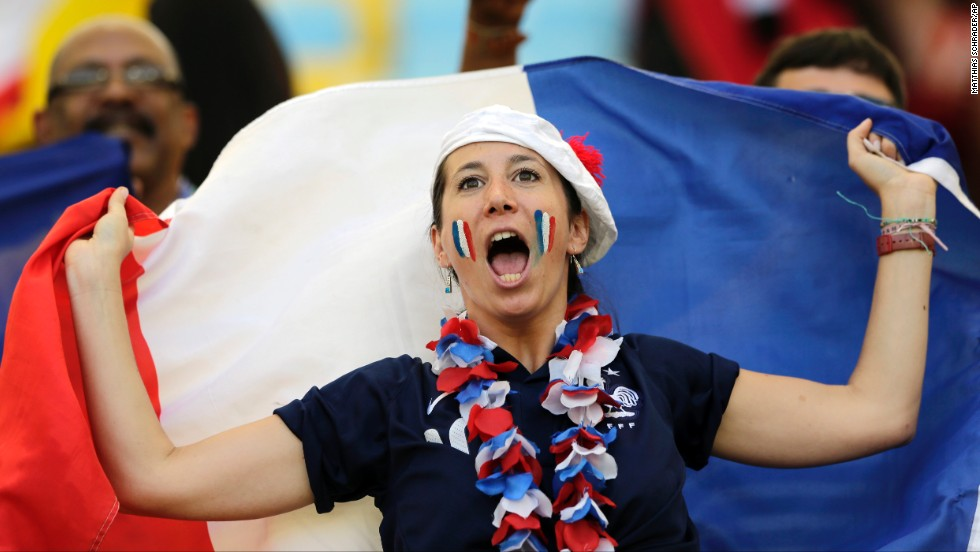 A France supporter cheers for her team.