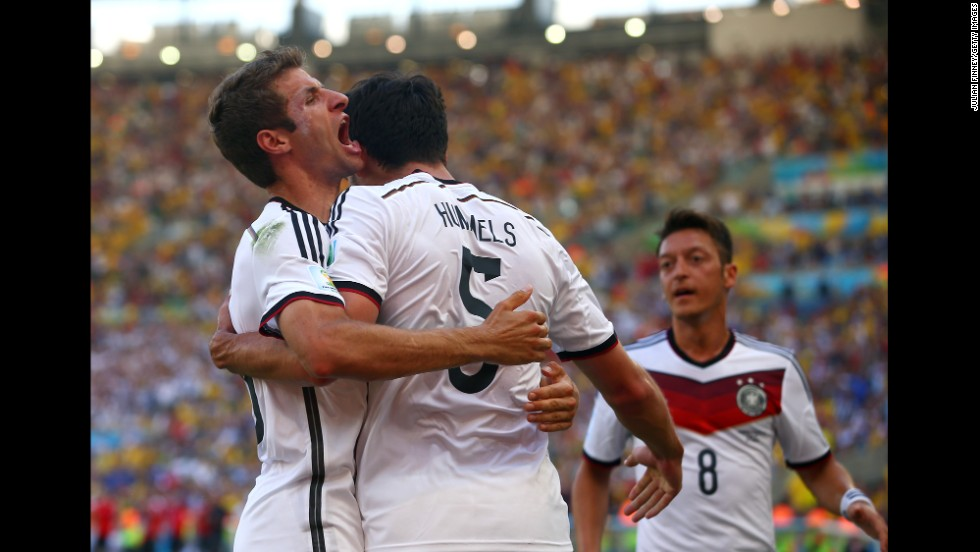 Mats Hummels celebrates with Mueller, left, and Oezil after his first-half header gave Germany a 1-0 lead.