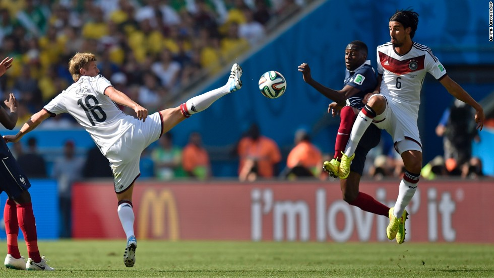 Germany's Toni Kroos, left, and Khedira challenge France's Blaise Matuidi.