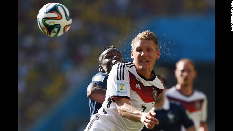Schweinsteiger and French midfielder Paul Pogba compete for the ball.