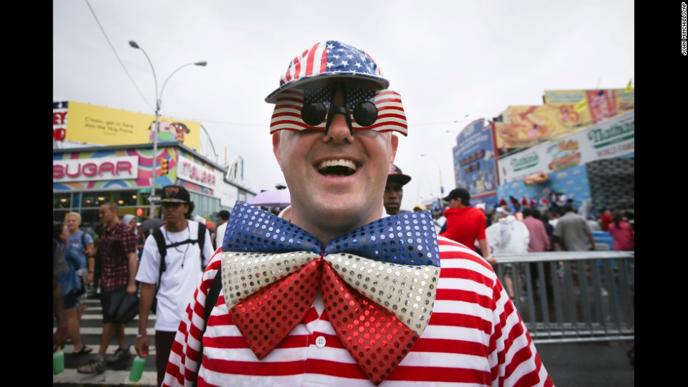 David Turner walks down Surf Avenue while wearing his American flag accessories.