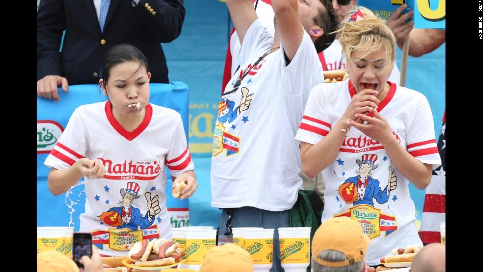 Sudo, right, eats next to last year's winner, Sonya Thomas.