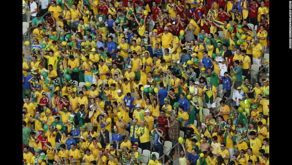 Brazil fans cheer their team.