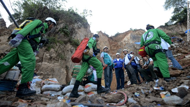 Rescuers take part in the operation to free three laborers trapped in a collapsed mine.