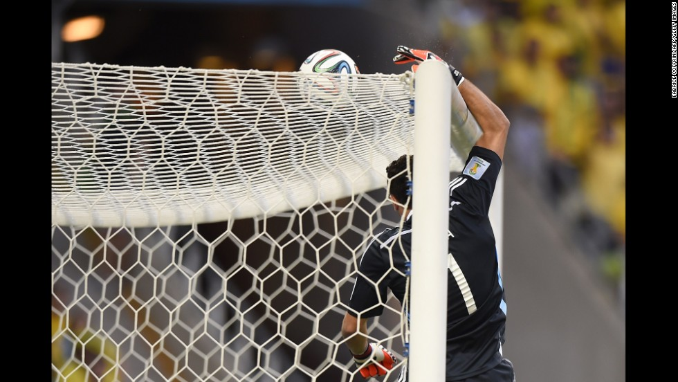 Colombian goalkeeper David Ospina tips a ball over the crossbar.