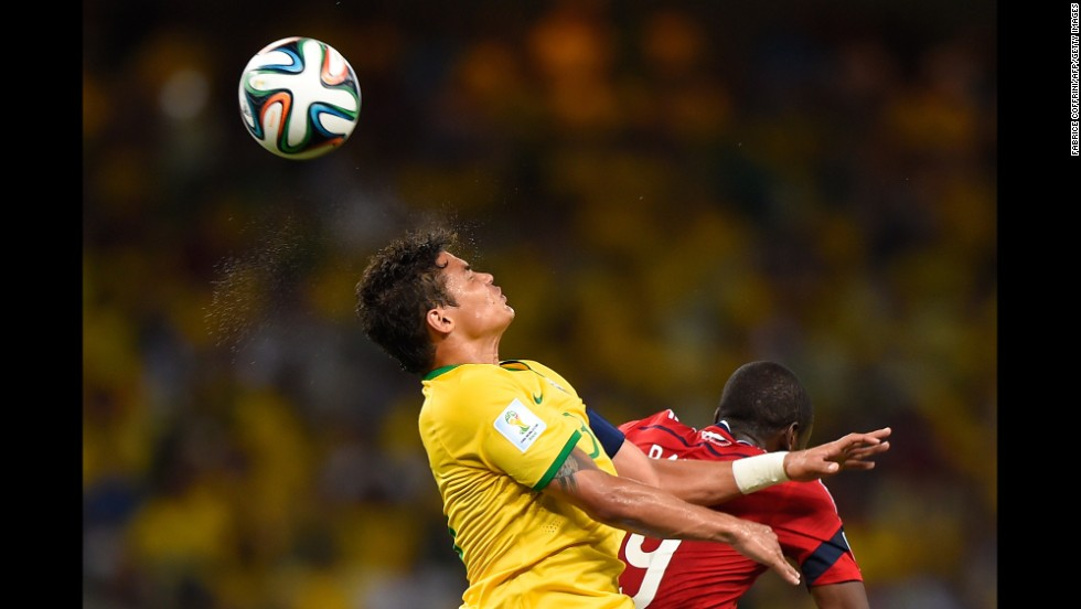 Thiago Silva fights for a header near Colombian forward Teofilo Gutierrez.