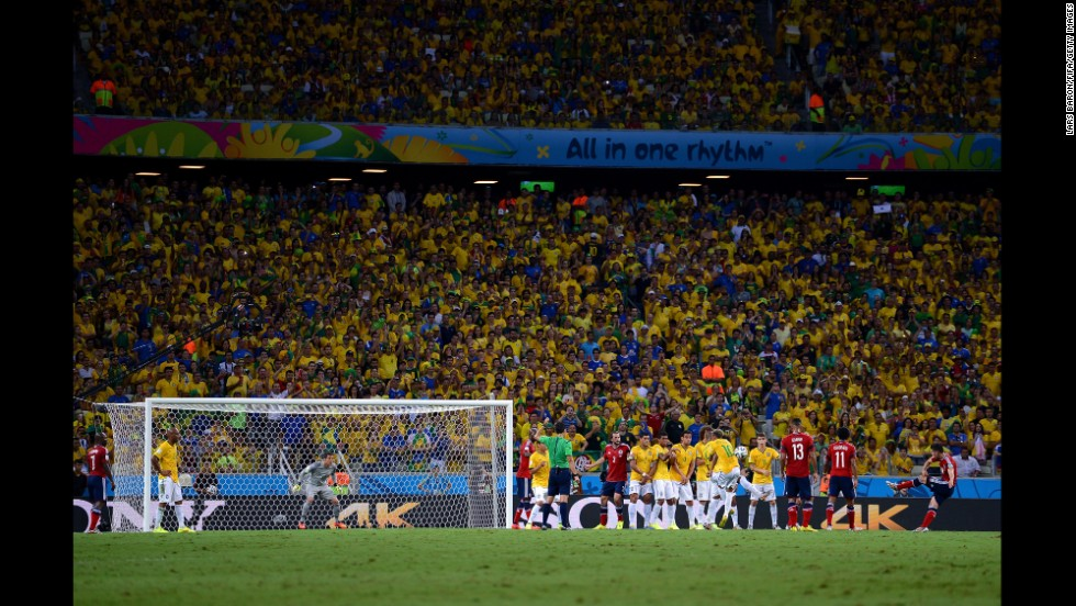 Colombia's James Rodriguez takes a free kick.