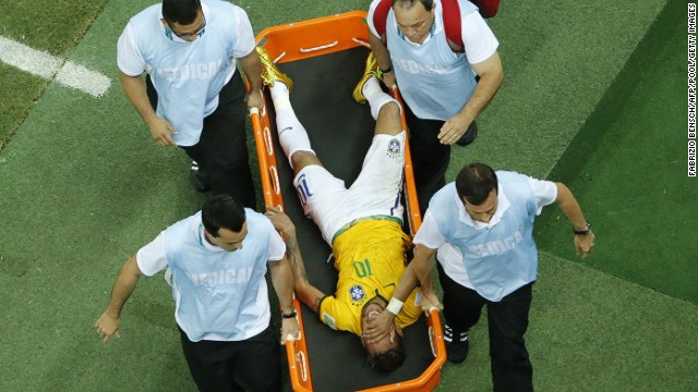 Brazil's forward Neymar is carried on a stretcher after being injured during the quarter-final football match between Brazil and Colombia at the Castelao Stadium in Fortaleza during the 2014 FIFA World Cup on July 4, 2014.