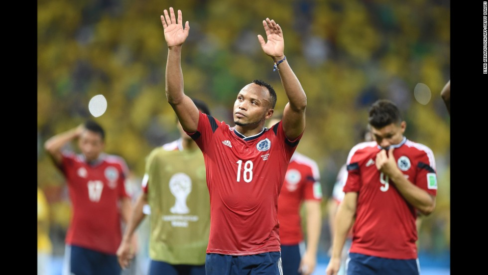 Colombia defender Juan Camilo Zuniga waves after the game.