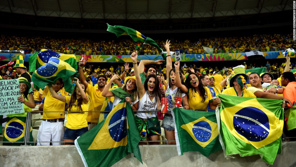 Brazil fans cheer during the quarterfinal match between Brazil and Colombia on Friday, July 4, in Fortaleza, Brazil.