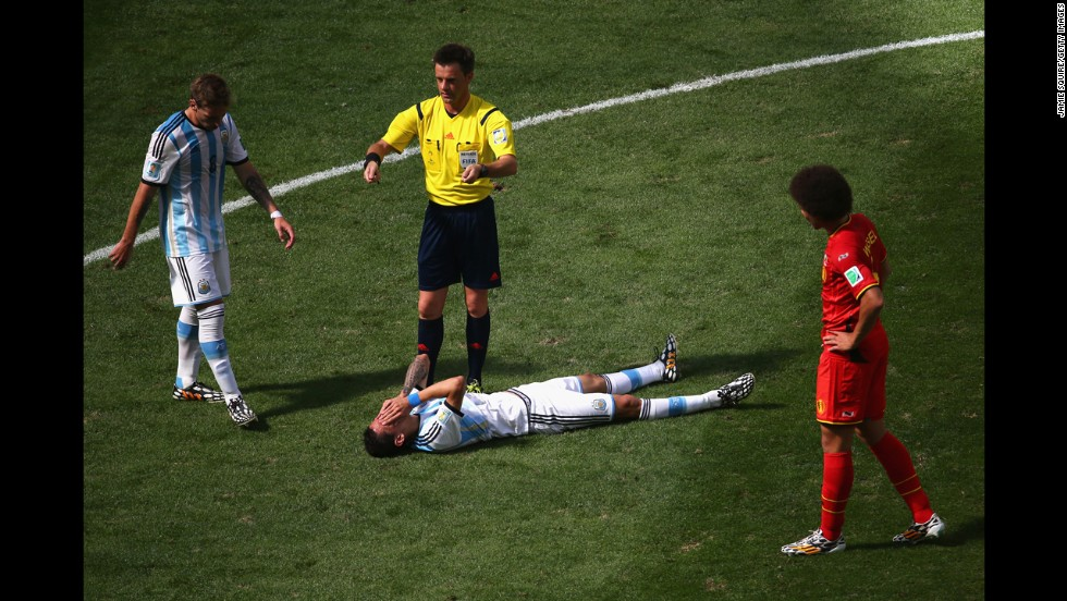 Angel di Maria of Argentina lies on the pitch.