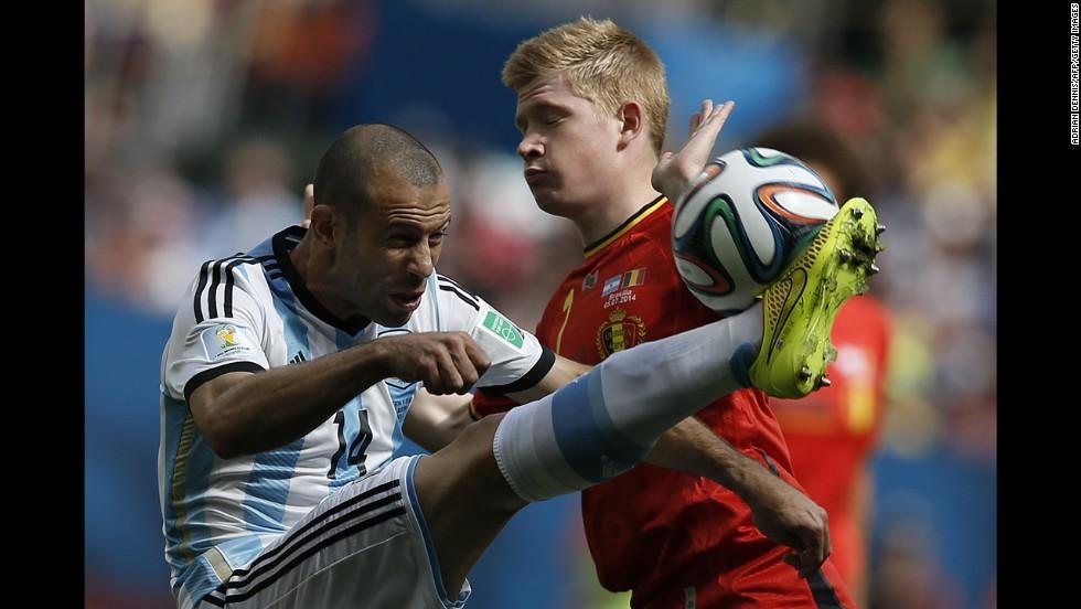 Argentina midfielder Javier Mascherano, left, vies with Belgium's Kevin De Bruyne.