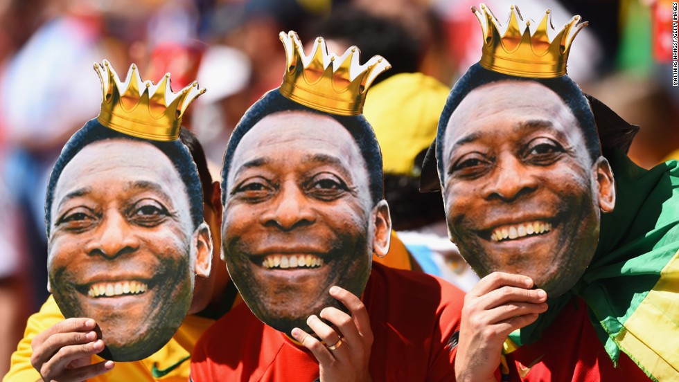 Fans hold up cutouts of Brazilian legend Pele prior to the match between Argentina and Belgium.