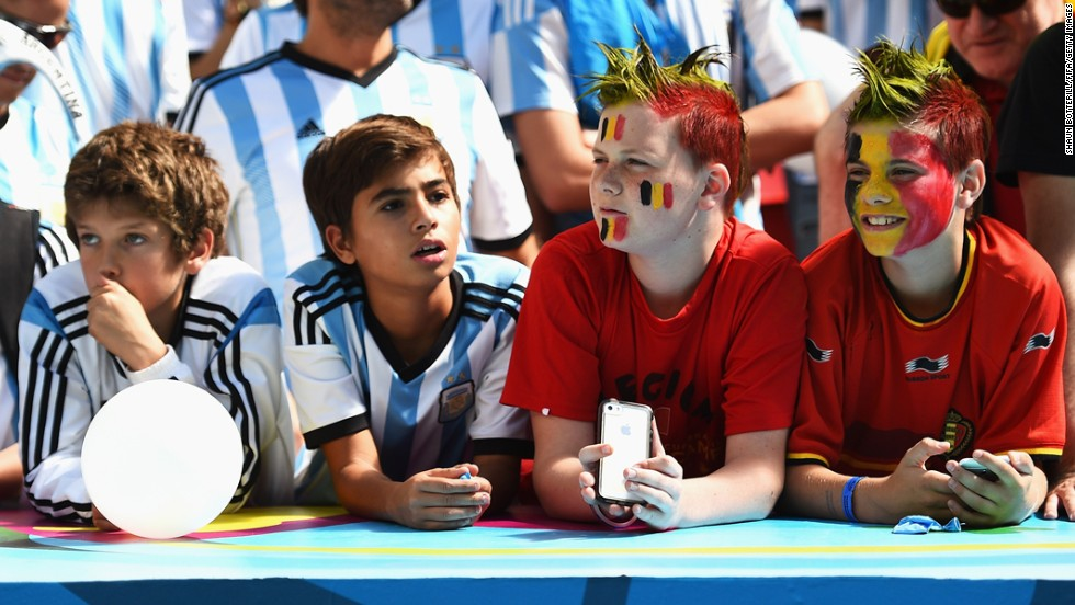 Young fans of both Argentina and Belgium cheer prior to the match.