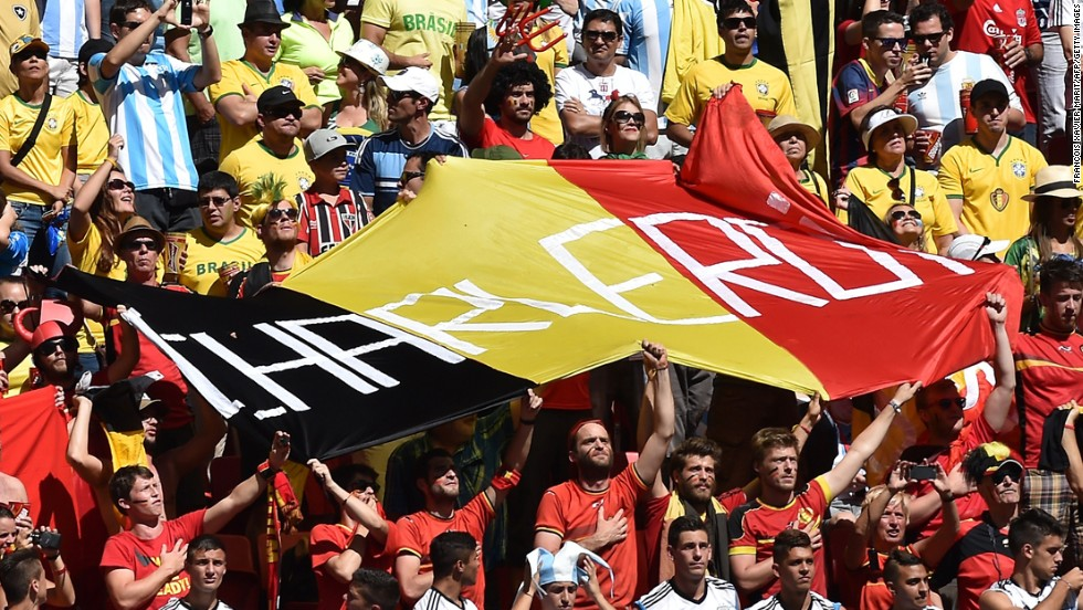 "Belgium fans hold up a huge flag before the match against Argentina. <a href=""http://www.cnn.com/2014/07/04/football/gallery/world-cup-0704/index.html"">See the best World Cup photos from July 4. </a>"