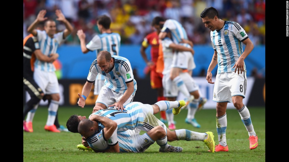 Martin Demichelis, left, Javier Mascherano, Pablo Zabaleta and Enzo Perez of Argentina celebrate their win.