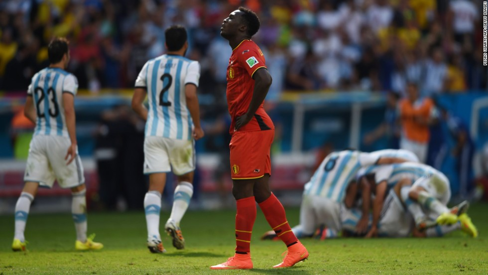 Belgium forward Romelu Lukaku walks away while Argentina celebrates.
