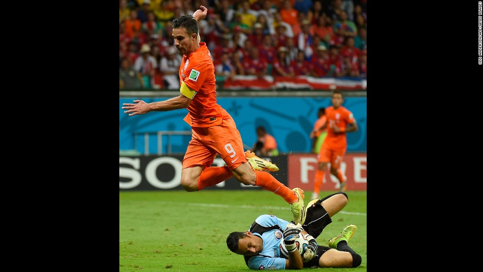 Netherlands forward and captain Robin van Persie, left, fails to score past Costa Rica goalkeeper Keylor Navas.