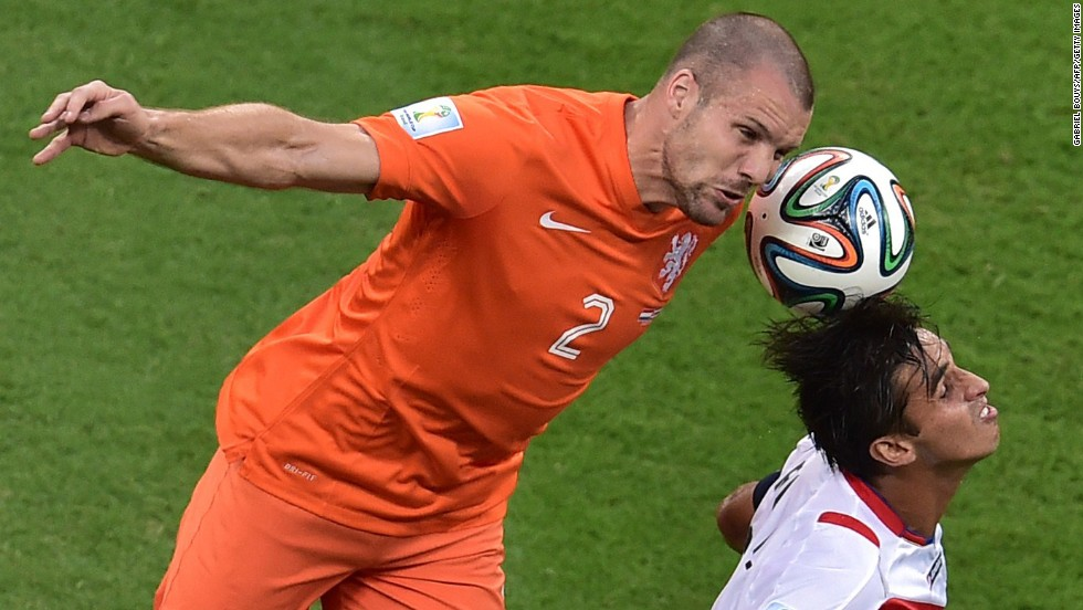 Netherlands' defender Ron Vlaar, left, vies with Costa Rica's forward and captain Bryan Ruiz.