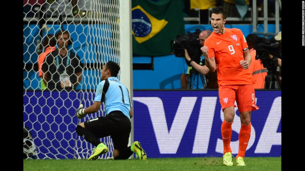 Netherlands forward and captain Robin van Persie celebrates after scoring past Costa Rica goalkeeper Keylor Navas.