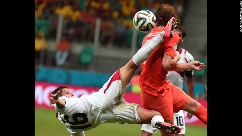 Costa Rica defender Cristian Gamboa, left, vies with Netherlands' defender Daley Blind.