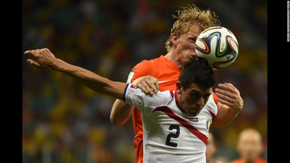 Costa Rica defender Johnny Acosta (front) vies with Netherlands' forward Dirk Kuyt.
