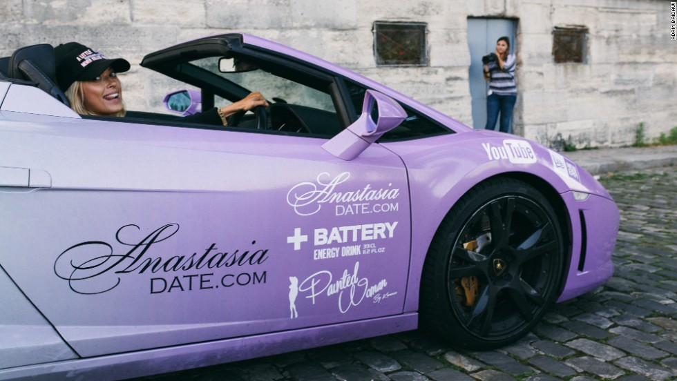 Dating website AnastasiaDate tricked out a Lamborghini into an electric violet chariot and threw two gorgeous women into the seats. The pair of Russians caused a sensation everywhere they went.
