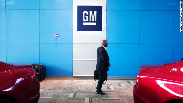 WARREN, MI - JUNE 5:  A person walks past the GM logo at the General Motors Technical Center as General Motors Chief Executive Officer Mary Barra holds a press conference on June 5, 2014 in Warren, Michigan. Barra spoke to provide an update on GM's internal investigation into the ignition switch recall at the General Motors Technical Center.  (Photo by Bill Pugliano/Getty Images)