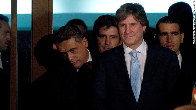 Argentine Vice President Amado Boudou (R) leaves Comdoro Py courtroom after being questioned about alleged influence-peddling in the acquisition of a company with a monopoly to print the national currency, in Buenos Aires, on June 9, 2014. The case, which marks the first time a sitting Argentine vice president has been taken to court, stems from a transaction in 2010 when Boudou was the country's economy minister. AFP PHOTO / ALEJANDRO PAGNI (Photo credit should read ALEJANDRO PAGNI/AFP/Getty Images)