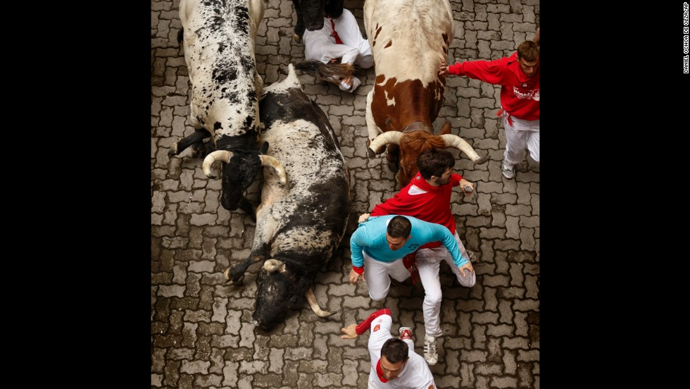 Some bulls fall as they race through Pamplona's narrow streets on July 7.