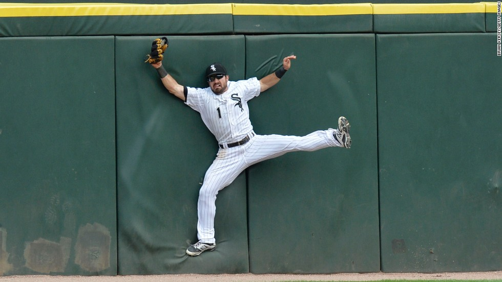 Adam Eaton of the Chicago White Sox slams into the outfield wall of Chicago's U.S. Cellular Field as he makes a catch against Seattle on Saturday, July 5.