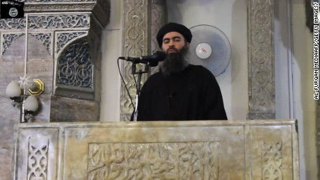 "An image grab taken from a propaganda video released on July 5, 2014 by al-Furqan Media allegedly shows the leader of the Islamic State (IS) jihadist group, Abu Bakr al-Baghdadi, aka Caliph Ibrahim, adressing Muslim worshippers at a mosque in the militant-held northern Iraqi city of Mosul. Baghdadi, who on June 29 proclaimed a ""caliphate"" straddling Syria and Iraq, purportedly ordered all Muslims to obey him in the video released on social media."
