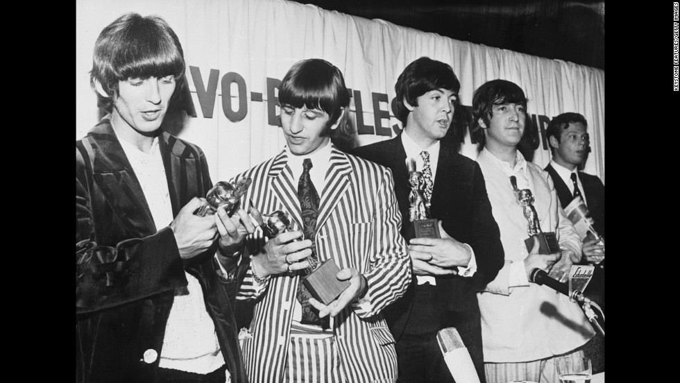 In 1966 The Beatles, pictured here with their manager Brian Epstein (right), received the Golden Otto award for being 'the best Beat group in the World', though judging by Ringo's striped suit and patterned tie, not necessarily the best dressed.