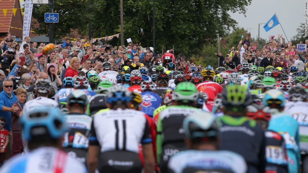 Tour de France stars get up close and personal with spectators on the opening stage in Yorkshire but they have complained about fans taking 'selfies' and not paying attention to the risk they pose to the riders.
