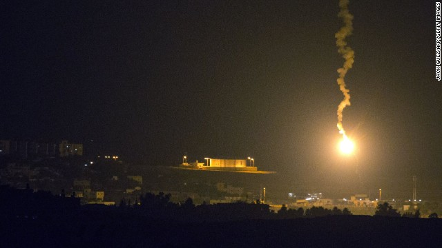 A picture taken from the southern Israeli border with the Gaza Strip shows Israeli flares illuminating the Palestinian coastal enclave, on July 7, 2014. Israeli air strikes on Gaza, that killed at least seven Palestinian militants overnight, came after a day in which armed groups fired at least 25 rockets and mortar rounds at southern Israel. The Gaza violence came as violence raged across annexed east Jerusalem and Arab towns in Israel following the kidnap and murder of a Palestinian teenager in a suspected revenge attack by Jewish extremists who burned him alive. AFP PHOTO / JACK GUEZ        (Photo credit should read JACK GUEZ/AFP/Getty Images)