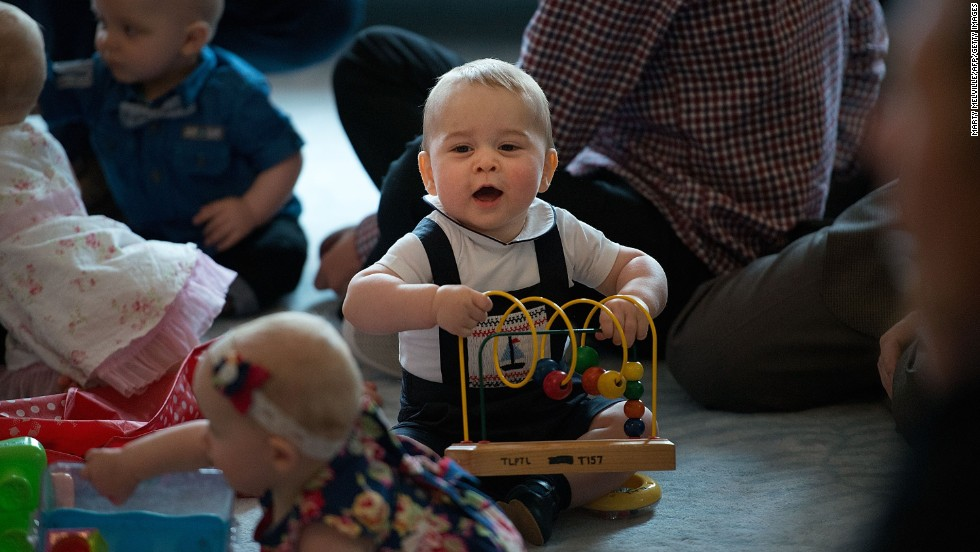 George plays with toys during a visit to the Government House in Wellington, New Zealand, in April 2014.