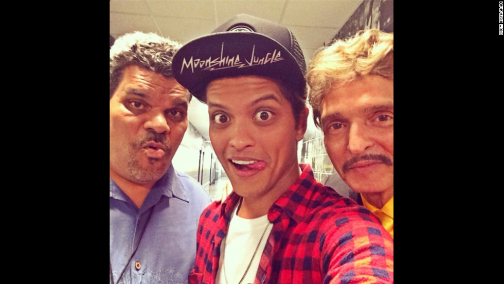 "Pop star Bruno Mars, center, <a href=""http://instagram.com/p/p-dxF_u82N/"" target=""_blank"">posted this selfie</a> of him with his father, right, and actor Luis Guzman on Thursday, July 3. ""Luis, and Pops tonight #Boston,"" he wrote on his Instagram account."