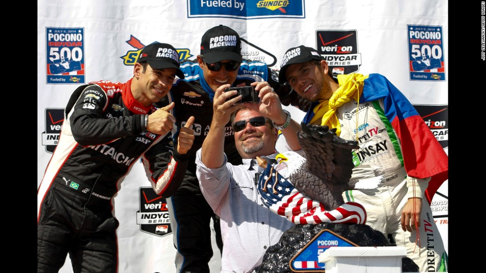 Brandon Igdalsky, the president of Pocono International Raceway, snaps a selfie with three IndyCar drivers Sunday, July 6, at the Pocono IndyCar 500 in Long Pond, Pennsylvania. Behind Igdalsky, from left, are drivers Helio Castroneves, Juan Pablo Montoya and Carlos Huertas.