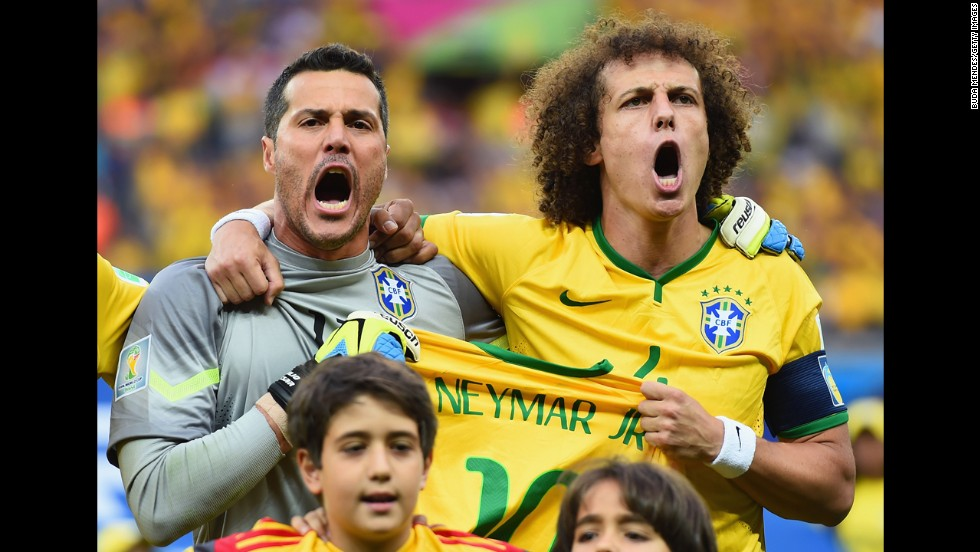 Julio Cesar, left, and David Luiz hold a Neymar jersey as they sing the national anthem prior to kickoff. Neymar was injured in the quarterfinals and couldn't continue to play in the tournament.