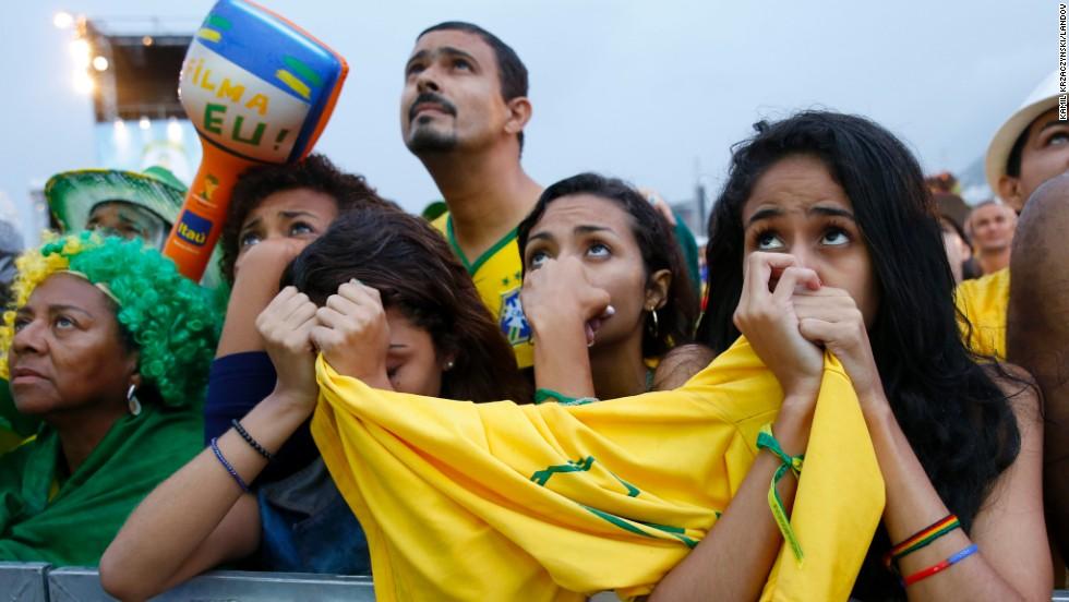 Fans of Brazil react while watching the match at Copacabana beach in Rio De Janeiro.