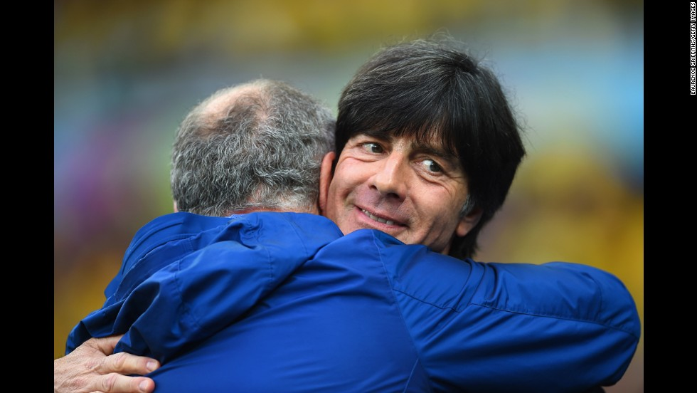 Brazil head coach Luiz Felipe Scolari, left, and German head coach Joachim Loew hug prior to the match.