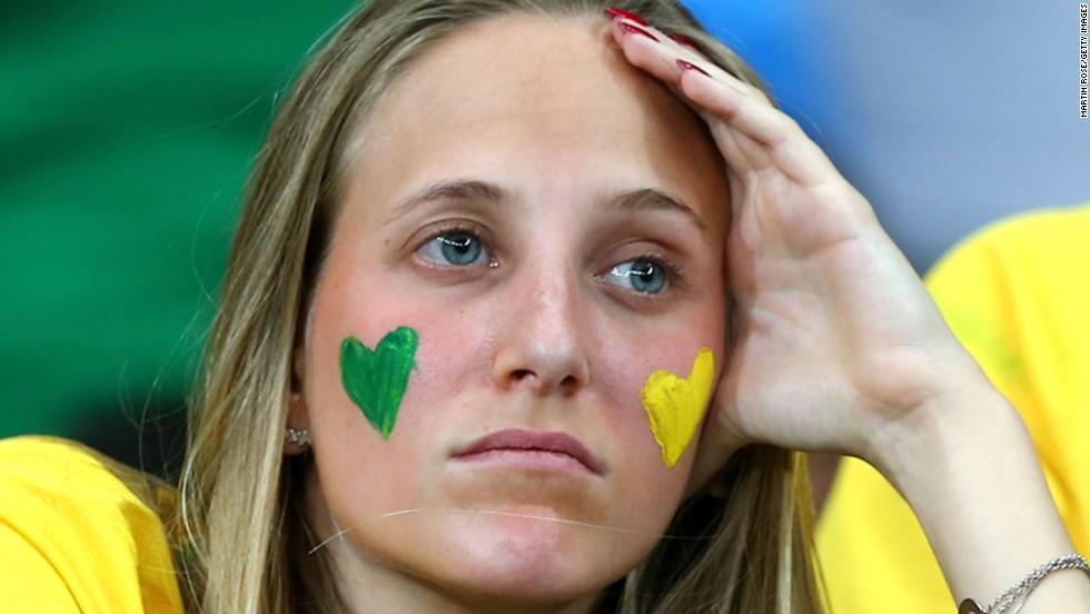 A Brazil fan looks on in the first half.